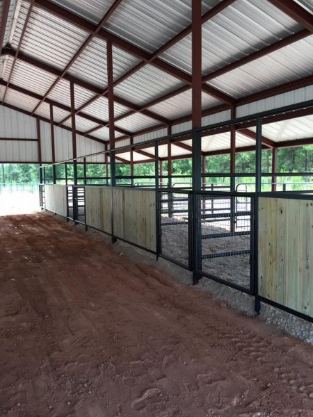 horse barn with stall fronts texas